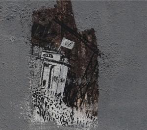 Frammento del murale di Blu che raffigura il centro sociale 'Atlantide' (dettaglio dell'immagine precedente)